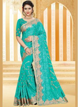 Alluring Faux Georgette Zari Work Traditional  Saree