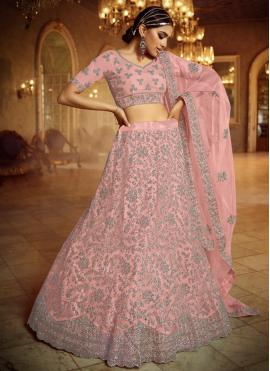 Conspicuous Net Embroidered Pink Lehenga Choli