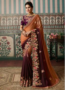 Embroidered Fancy Fabric Shaded Saree in Orange and Purple