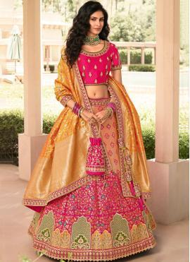 Intriguing Banarasi Silk Orange and Pink Zari A Line Lehenga Choli