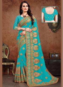 Titillating Resham Turquoise Designer Saree